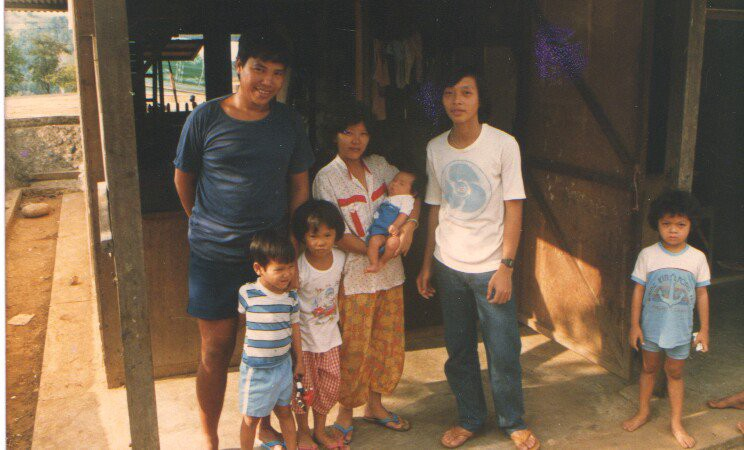 My family in the relocation camp in the Philippines after we were accepted to migrate to America. I am the infant in my mother's arms. My father is on the far left, my uncle next to my mom, my oldest sister (3) and older brother (2). A neighborhood kid on the far right.