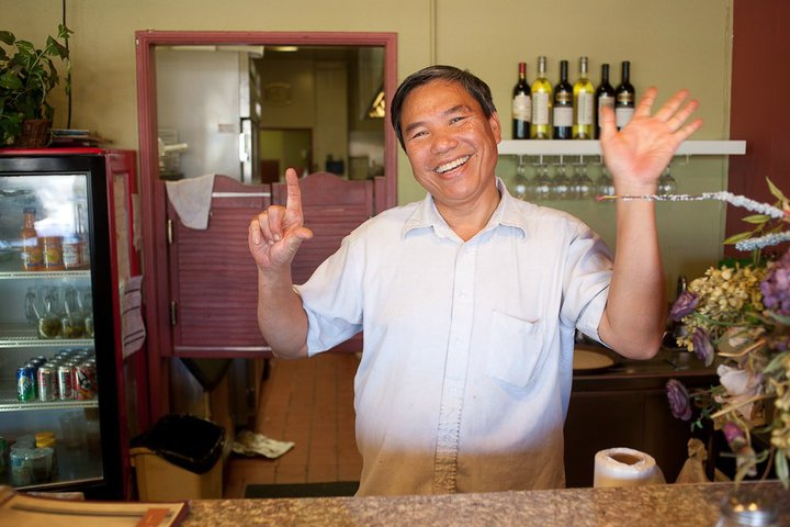 My dad, Trung Nguyen posing at the front desk for Long Hai Restaurant in Tustin, California.